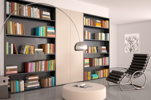 3d illustration of Interior of modern room for reading. The wall of the bookcase and books.